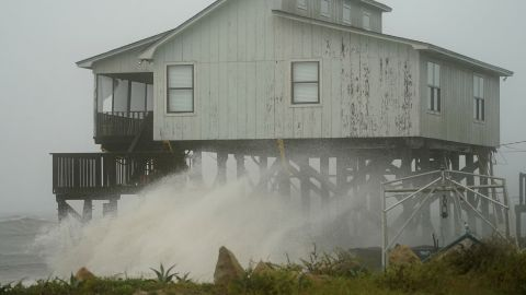 Waves hit a house in Alligator Point on October 10.