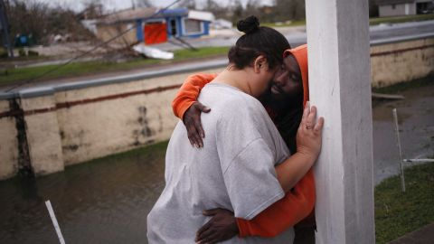 People comfort each other outside an apartment building in Panama City.