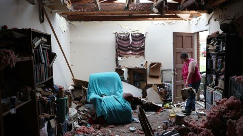 Amanda Logsdon faces a heavy cleanup task at her Panama City house on October 11.