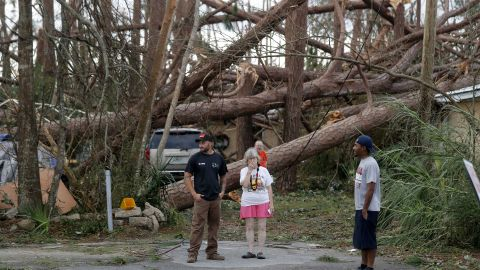 Joyce Fox stands in front of her heavily damaged home in Panama City on October 11.