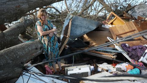 Kathy Coy stands among what is left of her home after Hurricane Michael destroyed it in Panama City, Florida. She said she was in the home when it was blown apart and is thankful to be alive.
