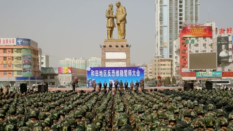 """TOPSHOT - This photo taken on February 27, 2017 shows Chinese military police attending an anti-terrorist oath-taking rally in Hetian, northwest China's Xinjiang Uighur Autonomous Region.  Islamic State militants from China's Uighur ethnic minority have vowed to return home and """"shed blood like rivers"""", according to a jihadist-tracking firm, in what experts said marked the first IS threat against Chinese targets. The threat came in a half-hour video released on February 27 by a division of the Islamic State in western Iraq and featuring militants from China's Uighur ethnic group, said the US-based SITE Intelligence Group, which analysed the footage. / AFP PHOTO / STR / China OUT        (Photo credit should read STR/AFP/Getty Images)"""