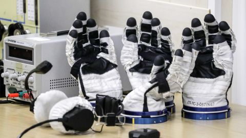 Gloves from the astronauts' space suits are checked ahead of the scheduled launch on October 11.