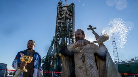 An Orthodox priest blesses the Soyuz-FG rocket booster launch site on Wednesday, October 10.