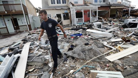 Firefighter Austin Schlarb performs a door-to-door search in Mexico Beach on October 11.