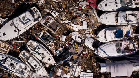 Storm-damaged boats are piled up in Panama City on October 11.