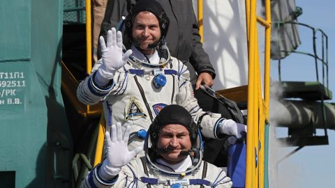 US astronaut Nick Hague, back, and Russian cosmonaut Alexey Ovchinin board the rocket prior to launch.
