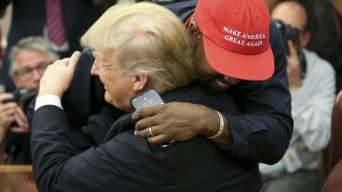 President Donald Trump hugs rapper Kanye West during a meeting in the Oval office of the White House on October 11, 2018 in Washington, DC.