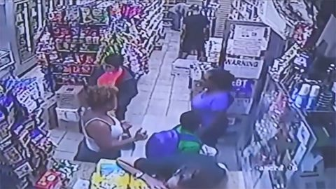 Surveillance video appears to show the boy's backpack brushing up against the woman's backside.