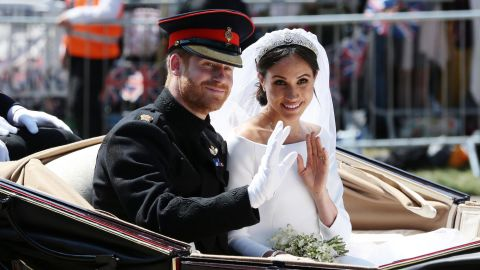 """Just after<a href=""""https://edition.cnn.com/interactive/2018/05/world/royal-wedding-cnnphotos/"""" target=""""_blank""""> getting married,</a> the newlyweds wave during their carriage procession in Windsor, England. <a href=""""https://www.cnn.com/interactive/2018/05/world/royal-wedding-gigapixel/index.html"""" target=""""_blank"""">Zoom in for a closer look</a>"""