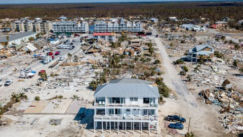 The Sand Palace stands out amid the wreckage.