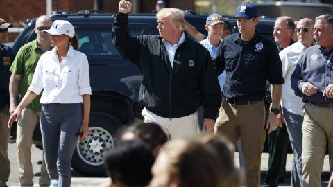 President Donald Trump and first lady Melania Trump tour areas affected by Hurricane Michael, Monday, Oct. 15, 2018, in Lynn Haven, Fla. (AP Photo/Evan Vucci)