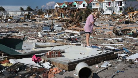 Lisa Patrick is overcome with emotion as she visits the remains of her home in Mexico Beach, Florida, on Monday, October 15.