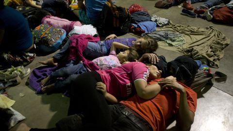 Honduran migrants sleep at an improvised shelter in Esquipulas, Guatemala, on Monday.