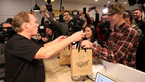 Canopy Growth CEO Bruce Linton hands Ian Power, who is first in line to purchase the first legal recreational marijuana after midnight, his purchases at a Tweed retail store in St John's, Newfoundland and Labrador, Canada October 17, 2018.  REUTERS/Chris Wattie