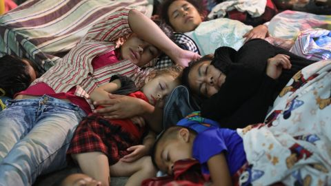Families in the caravan rest for the night in a community gym on Tuesday in Chiquimula, Guatemala. The caravan is the second of its size in 2018.