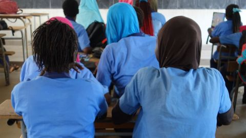 Schoolgirls in a classroom in a middle secondary school in Sédhiou, southern Senegal, in 2017. Photo by Elin Martínez for Human Rights Watch.