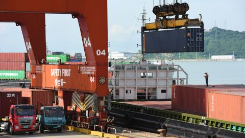 A container is loaded onto a ship in Shenzhen, China.