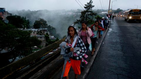 Honduran migrants leave Guatemala City, Guatemala, at sunrise on Thursday, October 18, 2018, as they make their way north toward the United States. Many of the more than 2,000 Hondurans in a migrant caravan trying to wend its way to the United States left spontaneously with little more than the clothes on their backs and what they could quickly throw into backpacks.