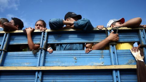 Honduran migrants in the caravan are pictured inside a truck on Thursday.