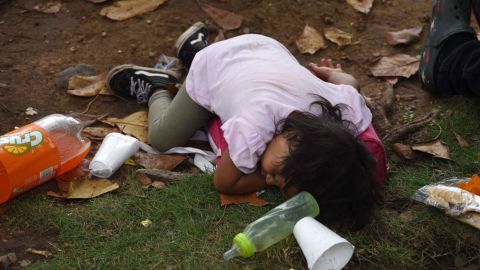 A child lies on the ground to rest as Honduran migrants take part in a caravan to the United States in Teculutan, Guatemala, on Wednesday.