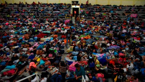 Honduran migrants heading to the United States rest at a gymnasium of a Catholic church in Chiquimula, Guatemala, on Tuesday, October 16, 2018. The caravan set out October 13 from the impoverished, violence-plagued country.
