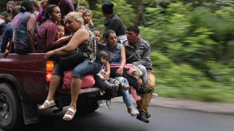 Honduran immigrants, some of more than 1,500 people traveling in a migrant caravan, move north on October 16, 2018 near Quezaltepeque, Guatemala. A caravan of Central Americans, the second of its kind in 2018, began in San Pedro Sula, Honduras with plans to march north through Guatemala and Mexico in route to the United States. Honduras has some of the highest crime and poverty rates in Latin America.