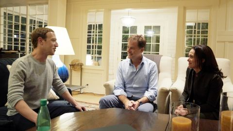 An undated handout from Facebook shows Zuckerberg and Sandberg meeting with Clegg.