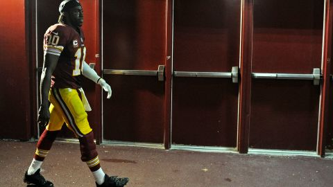 Quarterback Robert Griffin III of the Washington Redskins walks to the locker room after losing a close home game to the Philadelphia Eagles at FedEx Field on September 9, 2013.