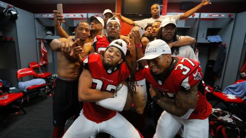 Jalen Collins #32 and Ricardo Allen #37 of the Atlanta Falcons strike a pose with teammates in the locker room after defeating the Green Bay Packers in the NFC Championship Game at the Georgia Dome on January 22, 2017 in Atlanta, Georgia.