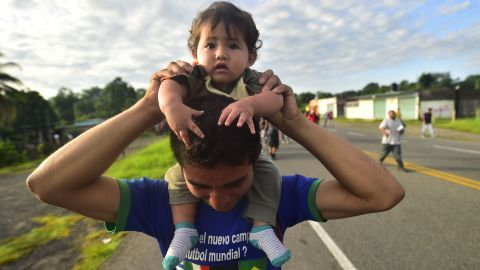 Honduran migrants, part of a caravan heading toward the United States, travel on the road linking Ciudad Hidalgo and Tapachula, Chiapas state, Mexico, on Sunday.