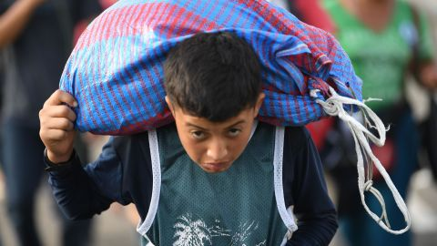 A Honduran migrant boy, part of a caravan heading to the United States, walks on the road linking Ciudad Hidalgo and Tapachula, Chiapas state, Mexico, on Sunday.