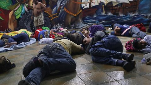Migrants still on the Guatemalan side of the border sleep at a temporary immigrant shelter on Sunday in Ciudad Tecun Uman, Guatemala. The caravan of thousands of Central Americans made its way into Mexico with some members hoping to eventually reach the United States.