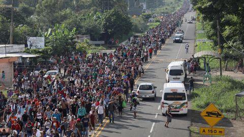 Members of the migrant caravan walk into the interior of Mexico after crossing the Guatemalan border on October 21, 2018 near Ciudad Hidalgo, Mexico.