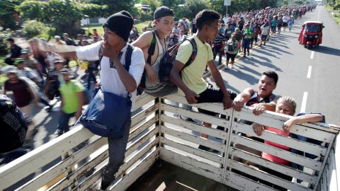 Central American migrants hitchhike along the highway near the border with Guatemala, as they continue their journey trying to reach the United States.
