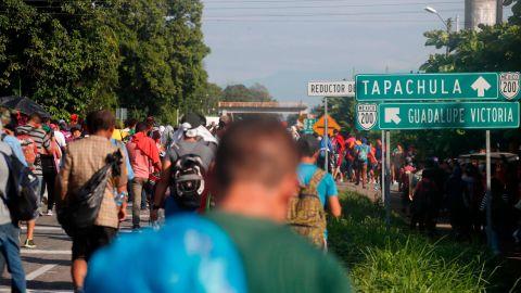 Central American migrants walk north toward Tapachula after departing Ciudad Hidalgo, Mexico.