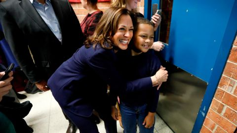 U.S. Sen. Kamala Harris, D-Calif., hugs eight-year-old Manaath Kai, of Des Moines, Iowa, after a get out the vote rally, Monday, Oct. 22, 2018, at Des Moines Area Community College in Ankeny, Iowa. (AP Photo/Charlie Neibergall)