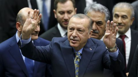 ANKARA, TURKEY - OCTOBER 23: Turkish President and leader of Turkey's ruling Justice and Development (AK) Party Recep Tayyip Erdogan greets the crowd as he attends his party's parliamentary group meeting at the Grand National Assembly of Turkey in Ankara, Turkey on October 23, 2018. (Photo by Ercin Top/Anadolu Agency/Getty Images)