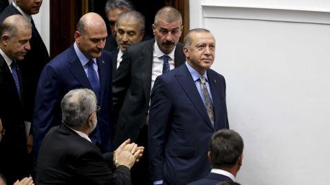 Erdogan is applauded inside the Turkish parliament in Ankara.