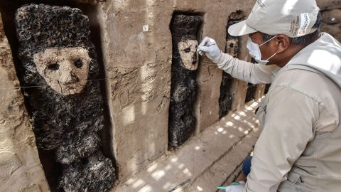 An expert works to uncover one of the 20 wooden sculptures which were recently discovered at the ancient archaeological site of Chan Chan, in the outskirts of the northern city of Trujillo, in Peru, on October 22, 2018, - The unique sculptures found in niches are fixed to the ground measuring an average of 70 centimeters and representing different characters. (Photo by CRIS BOURONCLE / AFP) / The erroneous mention[s] appearing in the metadata of this photo by CRIS BOURONCLE has been modified in AFP systems in the following manner: [20] instead of [19]. Please immediately remove the erroneous mention[s] from all your online services and delete it (them) from your servers. If you have been authorized by AFP to distribute it (them) to third parties, please ensure that the same actions are carried out by them. Failure to promptly comply with these instructions will entail liability on your part for any continued or post notification usage. Therefore we thank you very much for all your attention and prompt action. We are sorry for the inconvenience this notification may cause and remain at your disposal for any further information you may require.        (Photo credit should read CRIS BOURONCLE/AFP/Getty Images)