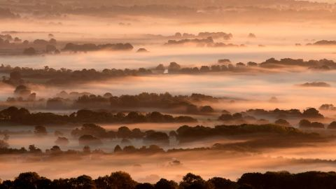 <strong>Amberley, United Kingdom</strong>: An enchanting mist fills lower-lying areas in South Downs National Park, which is in West Sussex near Amberly, England, in early October.