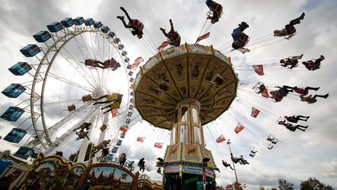 <strong>Stuttgart, Germany: </strong>Revelers ride a chain carousel at the 173rd Cannstatter Volksfest, a three-week long beer festival and fair. Stuttgart is in southwestern Germany, about a two-hour drive from the French border.