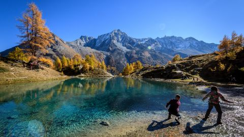 """<strong>Arolla, Switzerland</strong>: In mid-October in Arolla, western Switzerland, visitors throw stones in the """"Blue Lake."""" Algae and glacial clays colors the water this vivid blue."""