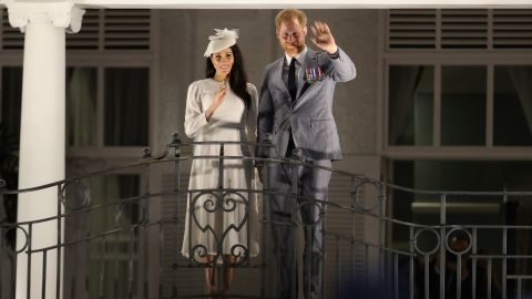 The royal couple wave from the balcony of the Grand Pacific Hotel in Suva.