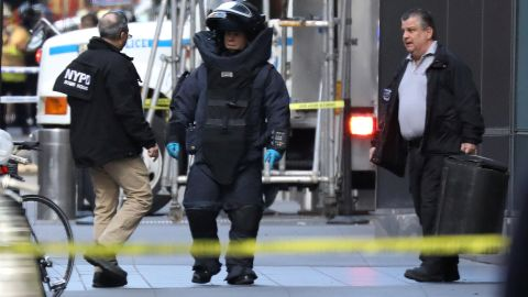 REFILE-CORRECTING TYPO  A member of the New York Police Department bomb squad is pictured outside the Time Warner Center in the Manhattan borough of New York City after a suspicious package was found inside the CNN Headquarters in New York, U.S., October 24, 2018.