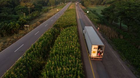 A truck of migrants heads in a caravan to the United States. Defense Secretary James Mattis is expected to sign deployment orders that could send 800 or more US troops to the border.