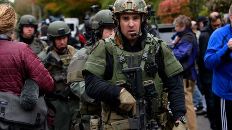 Rapid reaction SWAT members leave the scene of the mass shooting on Saturday.