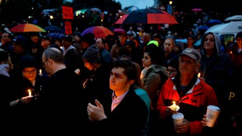 People hold candles as they gather for a vigil in the aftermath of a deadly shooting at the Tree of Life Synagogue, in the Squirrel Hill neighborhood of Pittsburgh, Saturday, Oct. 27, 2018. (AP Photo/Matt Rourke)