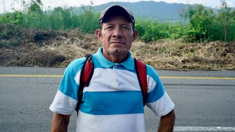 Carlos Gomez takes a break on the road north near Arriaga, Mexico.