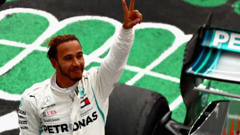 Lewis Hamilton savors the moment after clinching his fifth F1 world title with fourth place behind Max Verstappen in the Mexican Grand Prix.